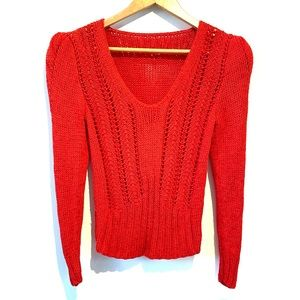 Red knit sweater with puffy shoulders
